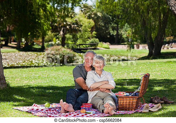 Elderly couple  picnicking in the g - csp5662084