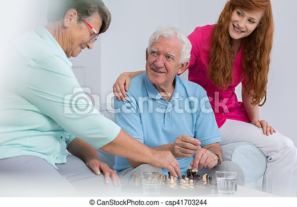 Elderly couple playing chess - csp41703244