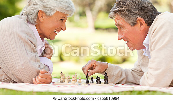 Elderly couple playing chess - csp5810994