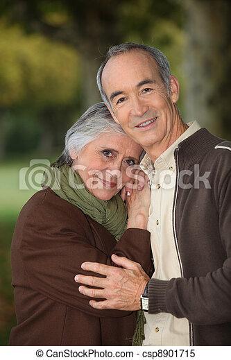 Elderly couple taking a walk - csp8901715