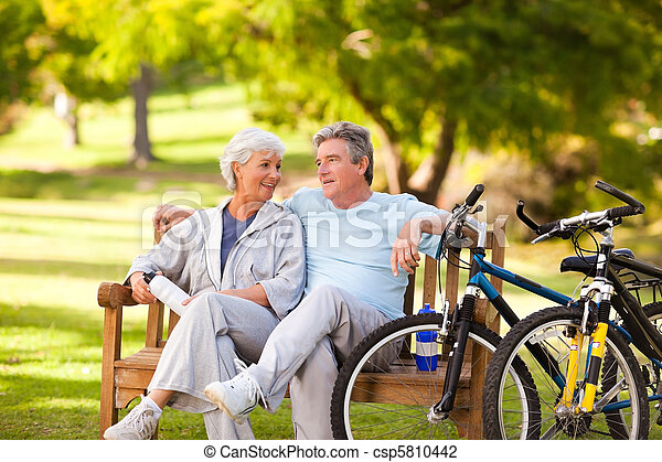 Elderly couple with their bikes - csp5810442