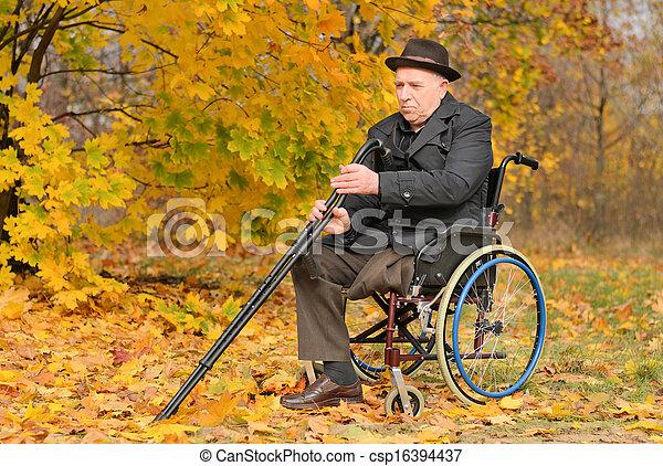 Elderly disabled man in his wheelchair - csp16394437