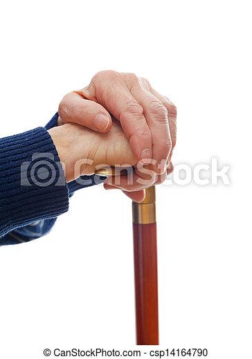 Elderly hands resting on stick - csp14164790