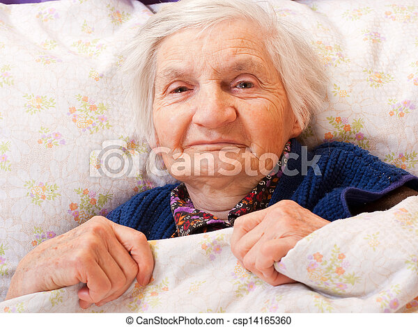 Elderly lonely woman rests in the bed - csp14165360