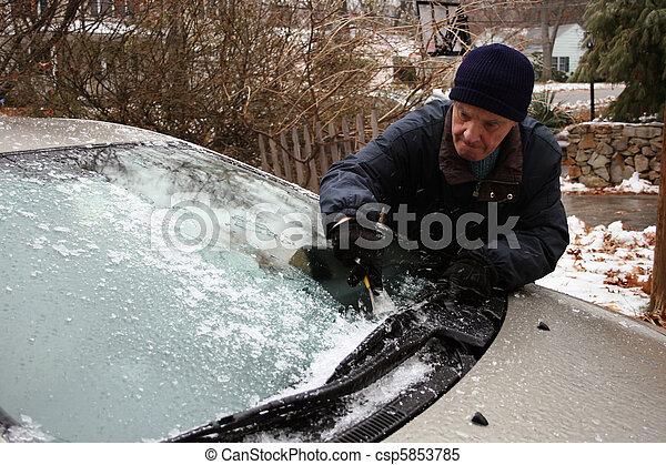 elderly man scraping windshield - csp5853785
