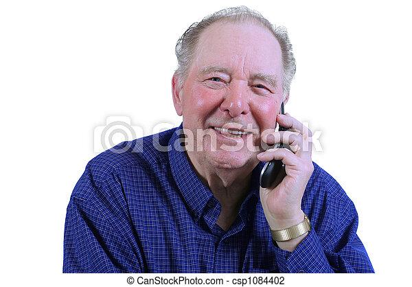 Elderly man using cell phone - csp1084402