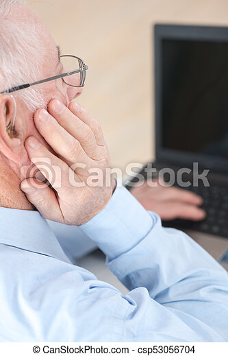 Elderly man using computer - csp53056704