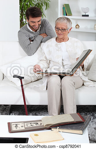 Elderly person looking at photos with son - csp8792041