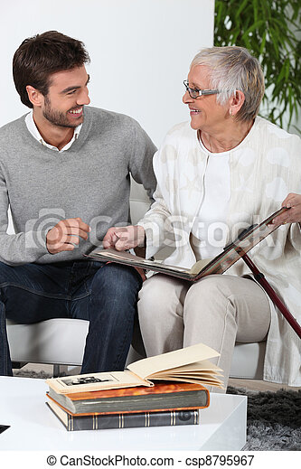 Elderly person looking at photos with son - csp8795967