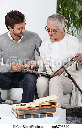 Elderly person looking at photos with son - csp8795840