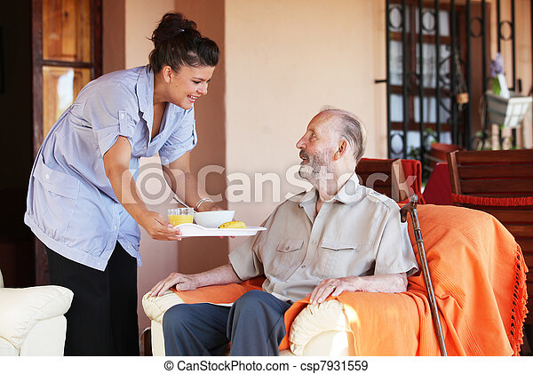 elderly senior being brought meal by carer or nurse - csp7931559