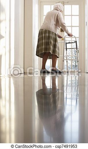 Elderly Senior Woman Using Walking Frame - csp7491953