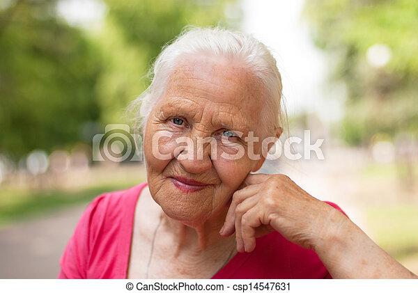 Elderly smiling woman - csp14547631