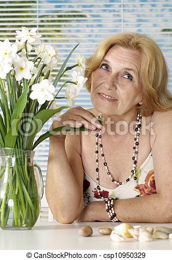 Elderly woman at a resort - csp10950329