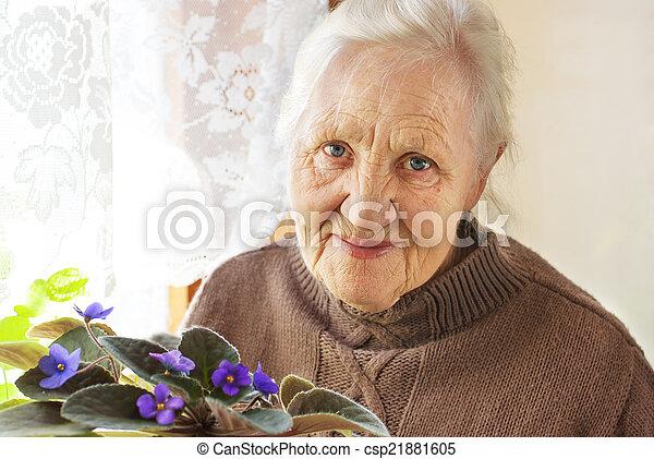 Elderly woman flower - csp21881605
