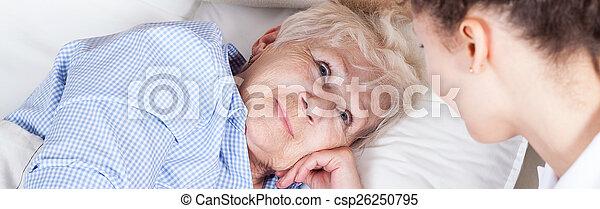 Elderly woman in bed - csp26250795
