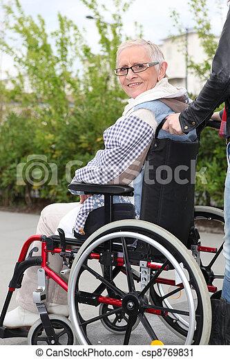Elderly woman in wheelchair - csp8769831