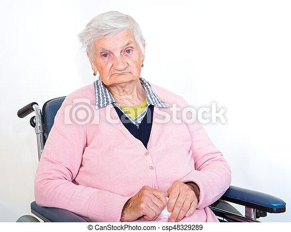 Elderly woman in wheelchair - csp48329289