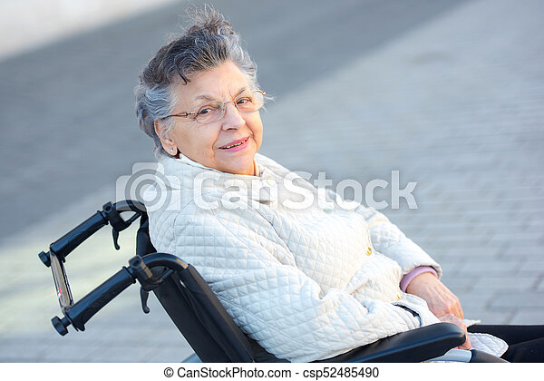 elderly woman in wheelchair posing - csp52485490