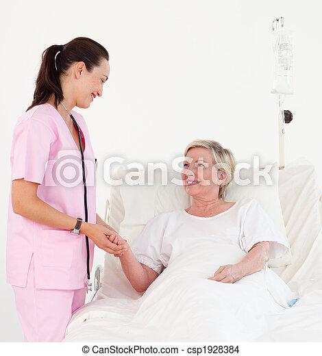 Elderly woman lying in hospital bed - csp1928384