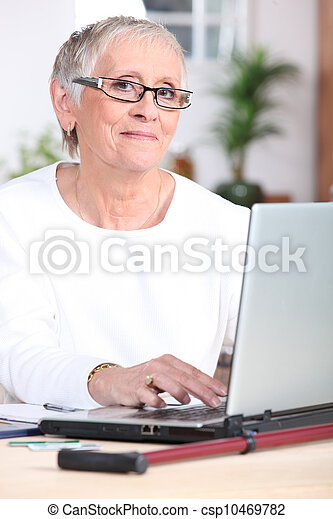 Elderly woman on laptop - csp10469782