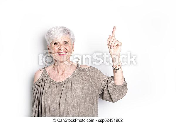 elderly woman on studio white background - csp62431962