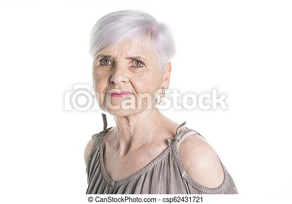 elderly woman on studio white background - csp62431721