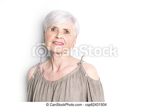 elderly woman on studio white background - csp62431934
