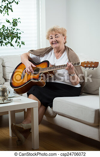 Elderly woman playing the guitar - csp24706072