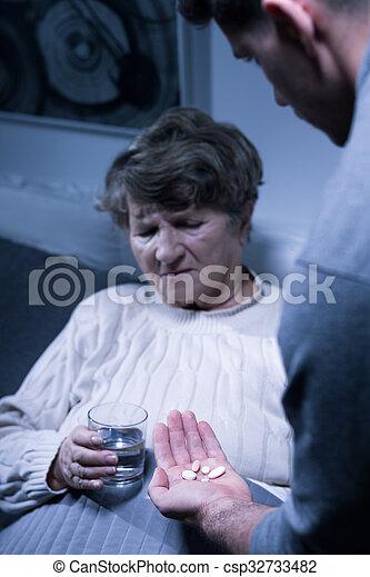 Elderly woman taking medicines  - csp32733482