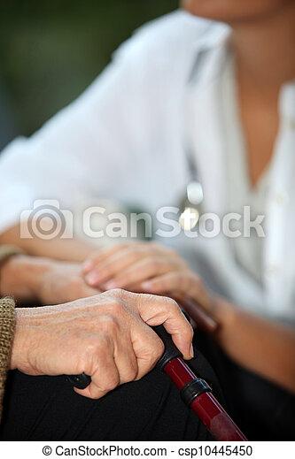 Elderly woman talking to a nurse - csp10445450