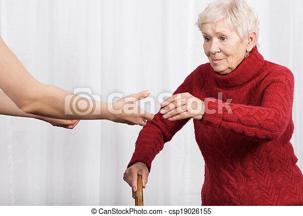 Elderly woman trying to walk  - csp19026155