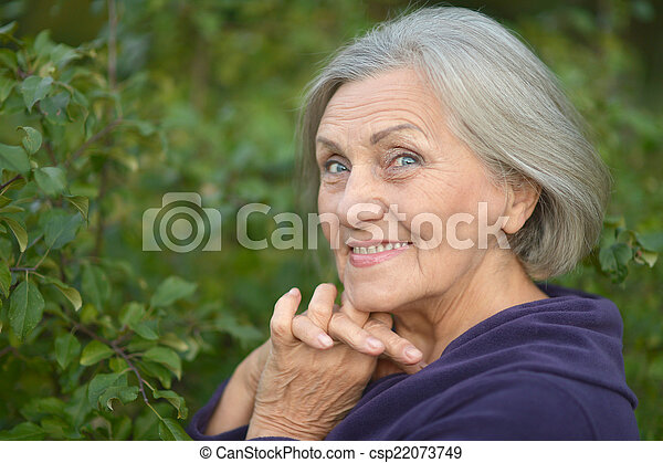 Elderly woman walking - csp22073749
