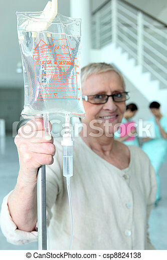 Elderly woman with a hospital drip - csp8824138