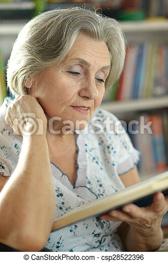 elderly woman with book - csp28522396