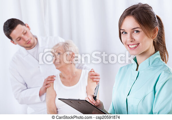 Elderly woman with doctors during rehabilitation - csp20591874
