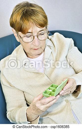 Elderly woman with pill box - csp1606385
