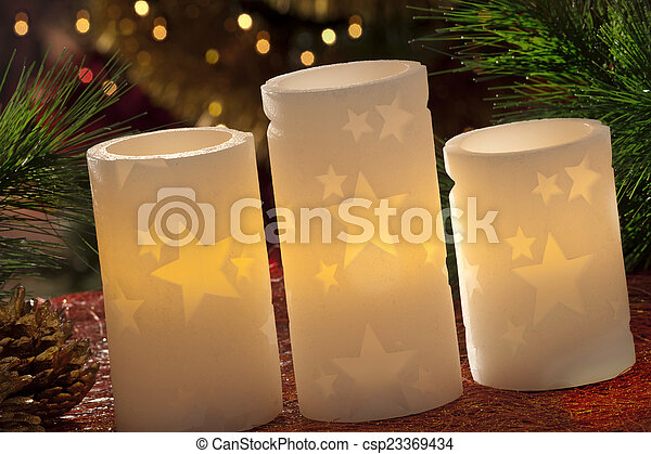 electric candles with christmas decorations in atmospheric light csp23369434 - Electric Christmas Candles