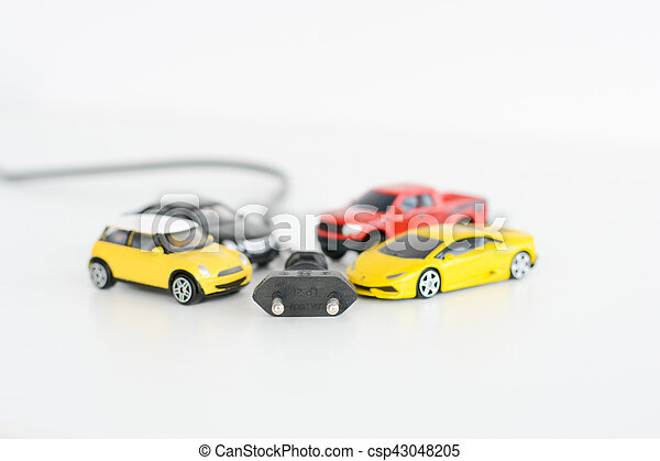 Electric Cars Concept With Toy Vehicles On White Background