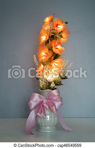 Electric Flower In Vase On Table With Wall Background