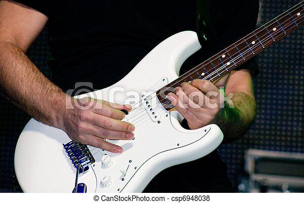 Electric guitar being played  - csp6948038