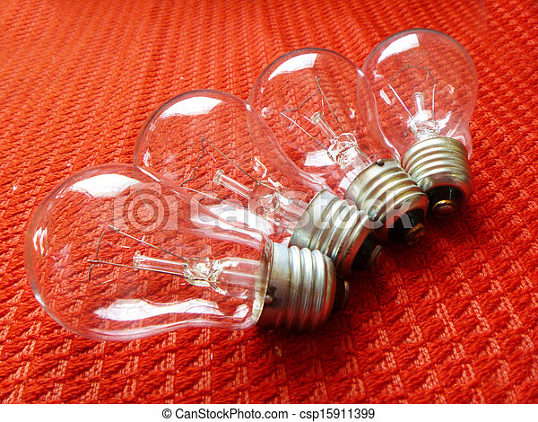 Electric light bulbs on red background - csp15911399