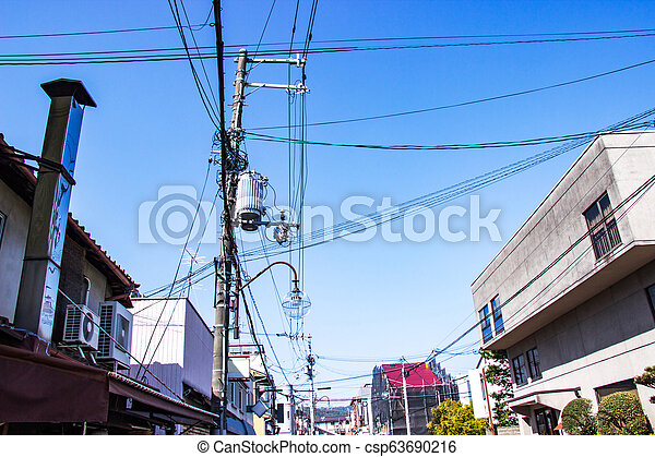 Electric pole with wires and lamp outdoor in the streets organized wiring  is neat at Japan bright sky background