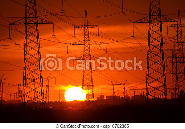 Electric power transmission lines at sunset - csp10702385