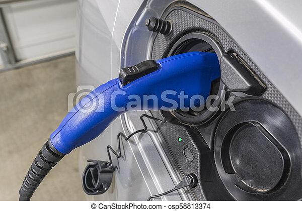 Electric Vehicle Plug Close Up - csp58813374