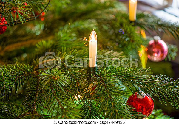Electrical Candle On A Christmas Tree