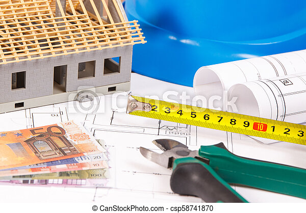 Electrical diagrams, work tools for engineer jobs, toy house under construction and currencies euro, building home cost concept - csp58741870