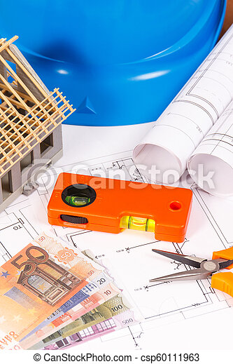 Electrical diagrams, work tools for engineer jobs, house under construction and currencies euro, building home cost concept - csp60111963