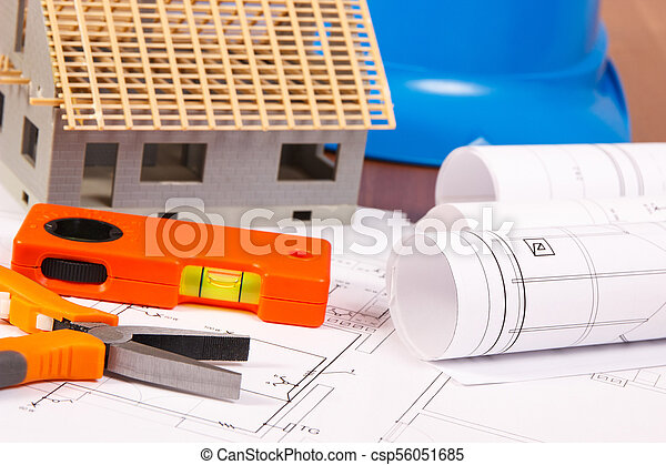 Electrical diagrams, work tools, helmet for engineer jobs and house under construction, building home concept - csp56051685