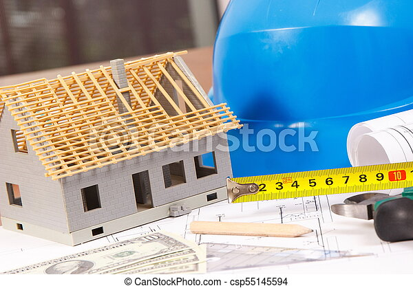 Electrical drawings, work tools and accessories for engineer jobs, small house and currencies dollar, building home cost concept - csp55145594